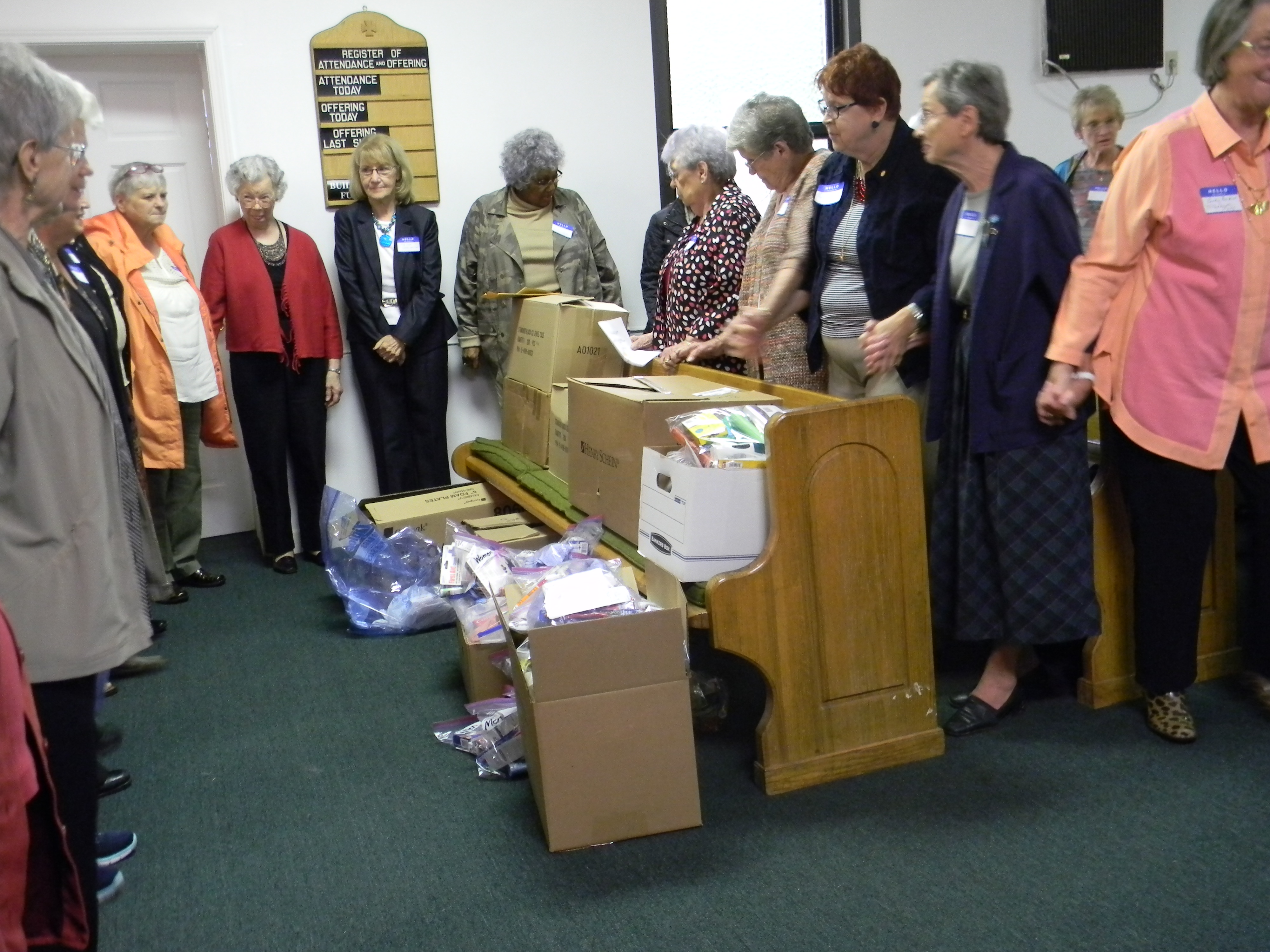 Praying over care kits